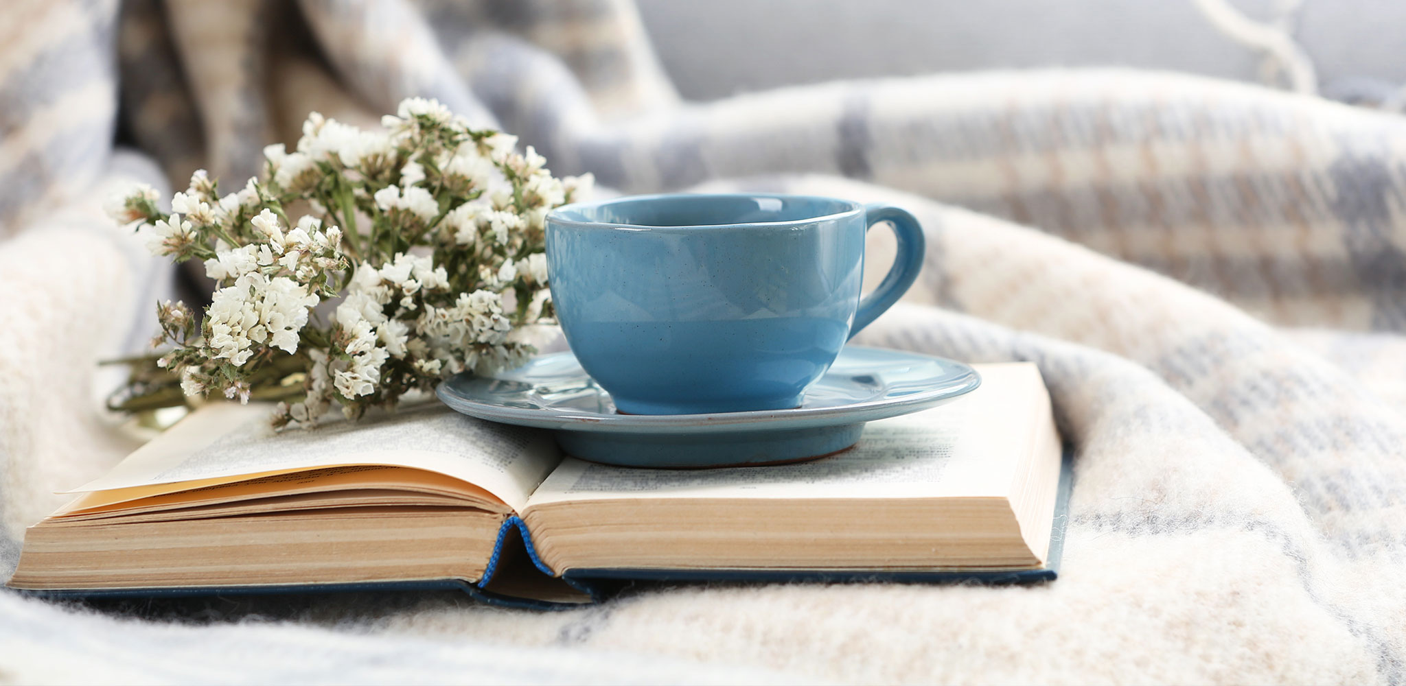 Coffee cup on a book in a relaxing environment
